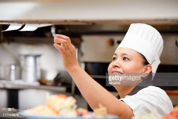 Portrait of happy smiling cook inside the restaurant kitchen