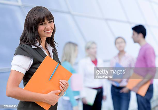 Portrait of happy smiling young woman with student group (XL)