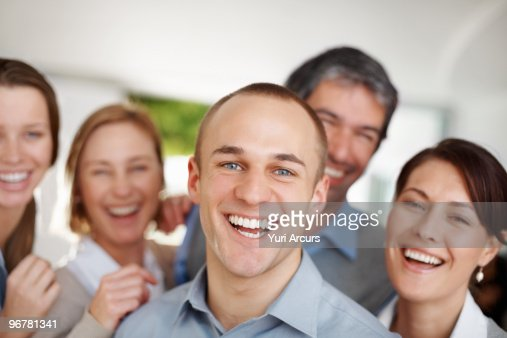 Portrait of happy successful young business people : Stock Photo
