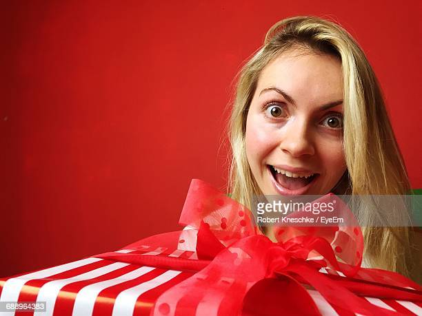 Portrait Of Happy Surprised Woman With Christmas Gift