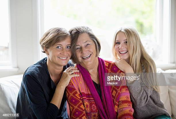 Portrait of happy three generation females in living room