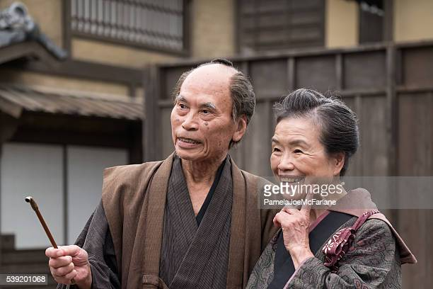 Portrait of Happy, Traditionally Dressed Senior Japanese Couple Outside Home