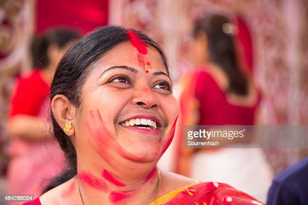 Portrait of happy woman after applying Vermilion during Durga Puja