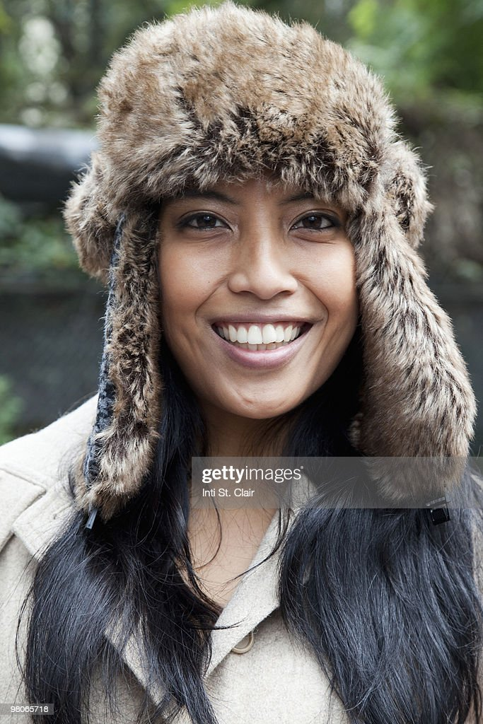Portrait of happy woman in fur hat and winter coat : Stock Photo