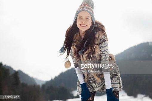 Portrait of happy woman in snow : Stock Photo