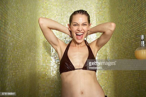 Portrait of happy woman taking a shower