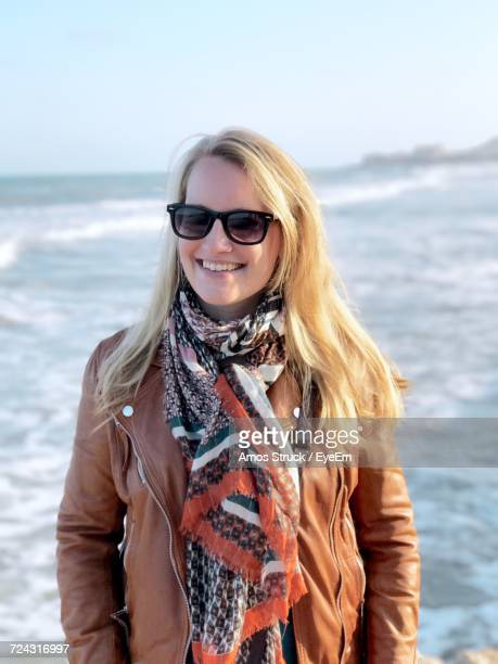 Portrait Of Happy Woman With Blond Hair By Sea
