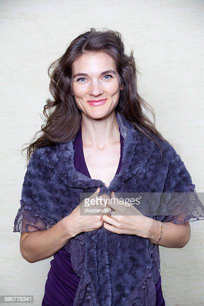 Portrait of happy woman with purple shawl