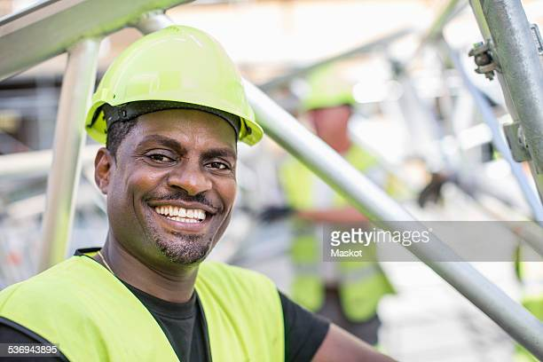 Portrait of happy worker at construction site