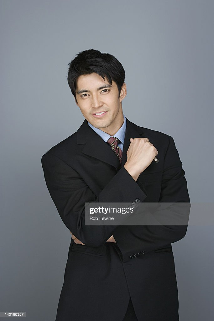Portrait of happy young businessman : Stock Photo