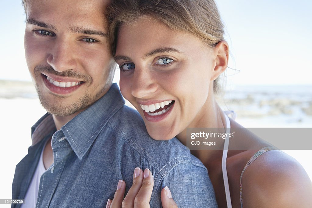 Portrait of happy young couple embracing : Stock Photo