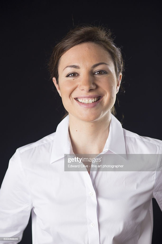 Portrait of happy young lady in white shirt