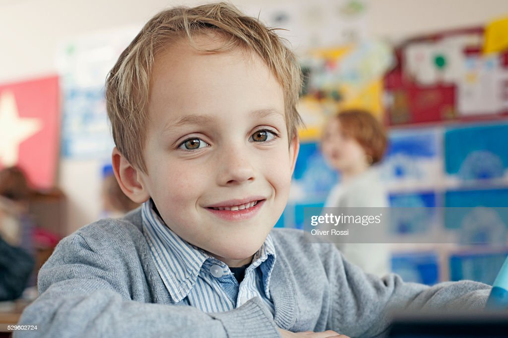 Portrait of happy young school boy (6-7) : Stock Photo