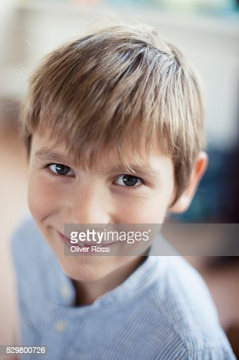 Portrait of happy young school boy (6-7) : Bildbanksbilder