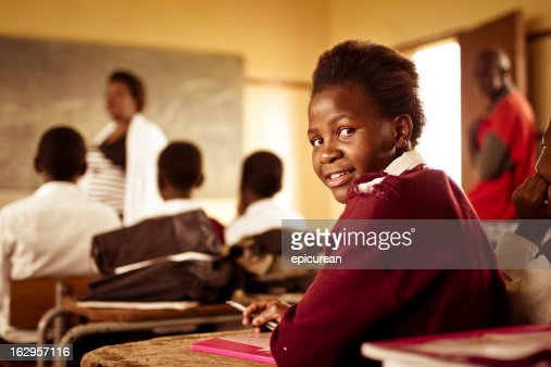 Portrait of happy Young South African girl in classroom