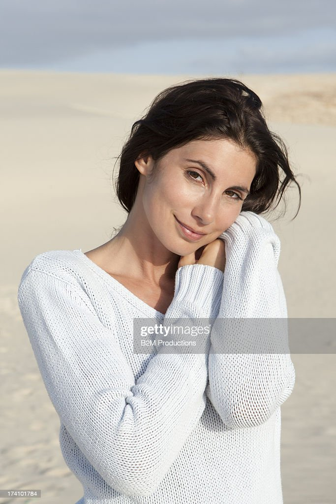 Portrait Of Happy Young Woman In Desert