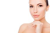 Portrait of healthy beautiful woman in spa salon touching chin