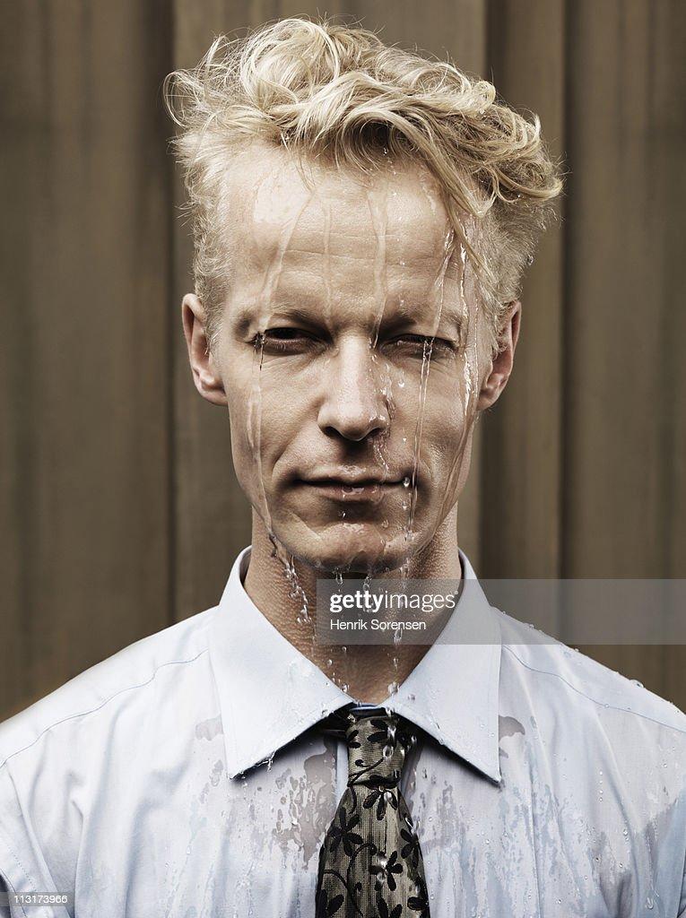 Portrait of heavily sweating businessman : Stock Photo