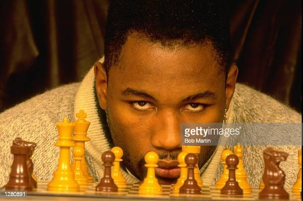 Portrait of Heavyweight boxer Lennox Lewis of Great Britain playing chess Mandatory Credit Bob Martin/Allsport