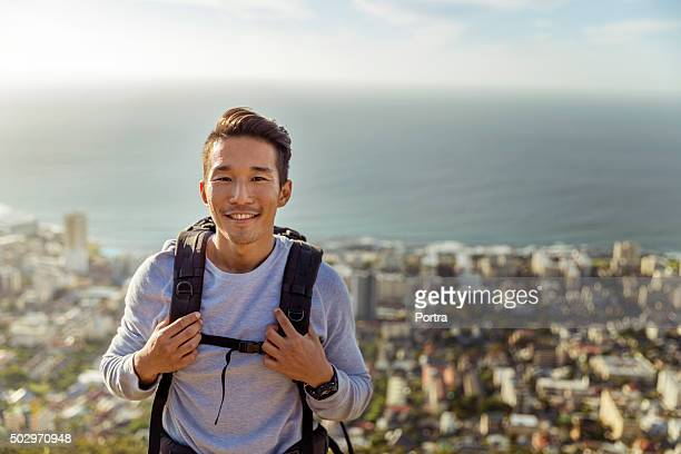 Portrait of hiker smiling against sea