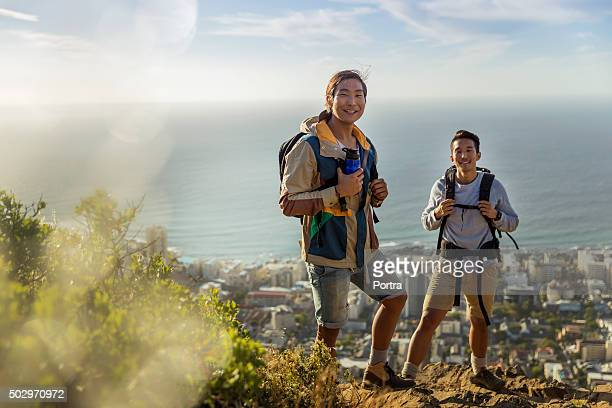 Portrait of hikers against sea