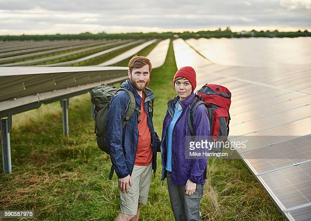 Portrait of hikers in solar farm