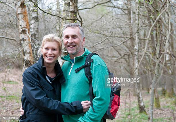 Portrait of hiking couple walking in woods