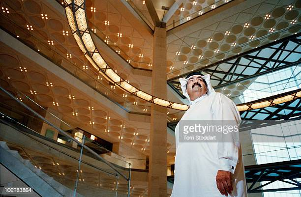 A portrait of His Highness the Emir Sheikh Hamad bin Khalifa AlThani inside the new Museum of Islamic Art in Doha Qatar The country's huge oil and...