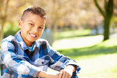 Portrait Of Hispanic Boy In Countryside Smiling To Camera