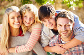 Portrait Of Hispanic Family In Countryside Smiling To Camera