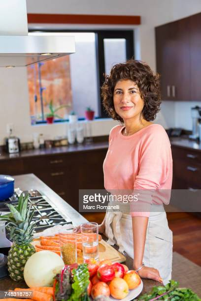 portrait of Hispanic woman in domestic kitchen