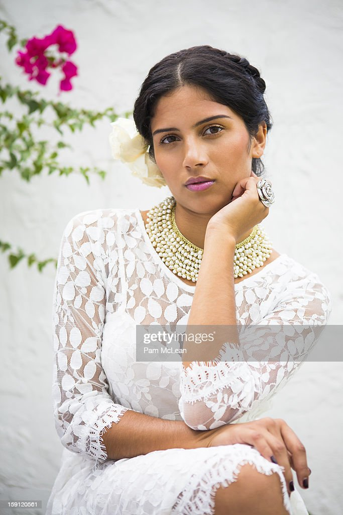 Portrait of Hispanic woman in white lace dress : Stock Photo