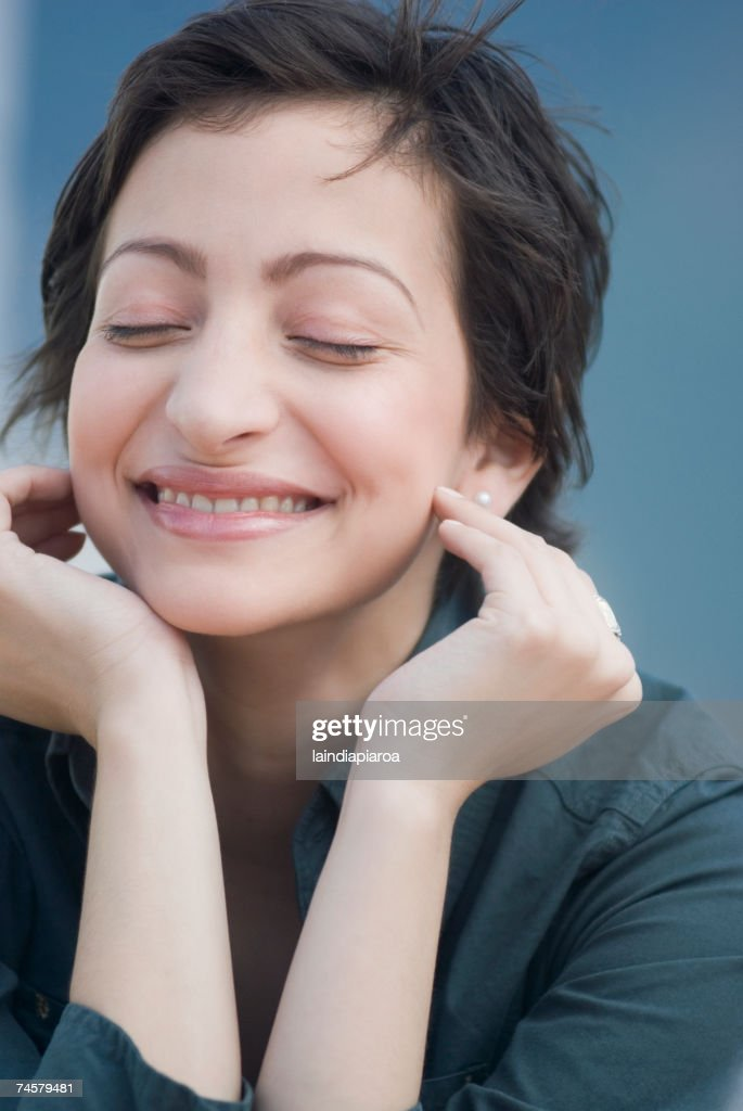 Portrait of Hispanic woman with eyes closed : Stock Photo