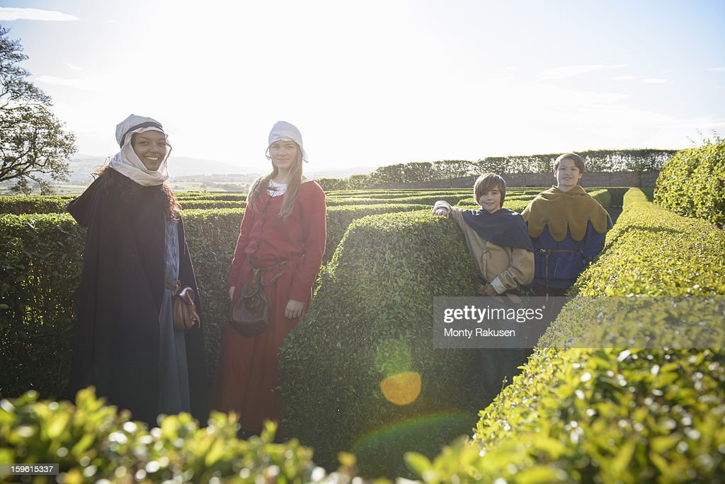 Portrait of history students in period dress in maze, Bolton Castle, a 14th century Grade 1 listed building, Scheduled Ancient Monument : Stock Photo