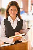 Portrait of hostess in restaurant