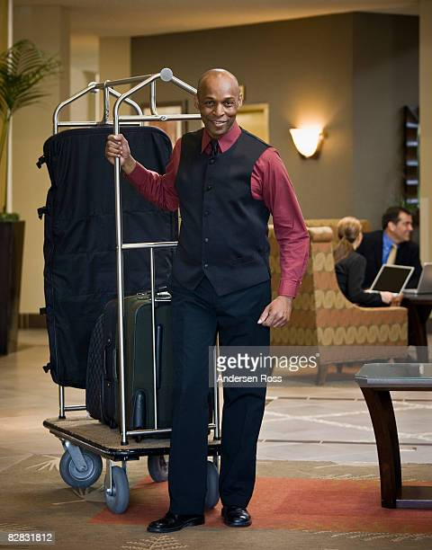 Portrait of hotel staff with luggage