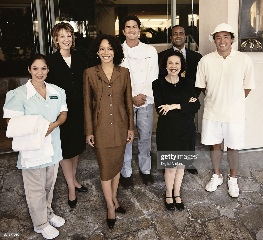 Portrait of Hotel Workers Standing Together at an Entrance : Stock Photo