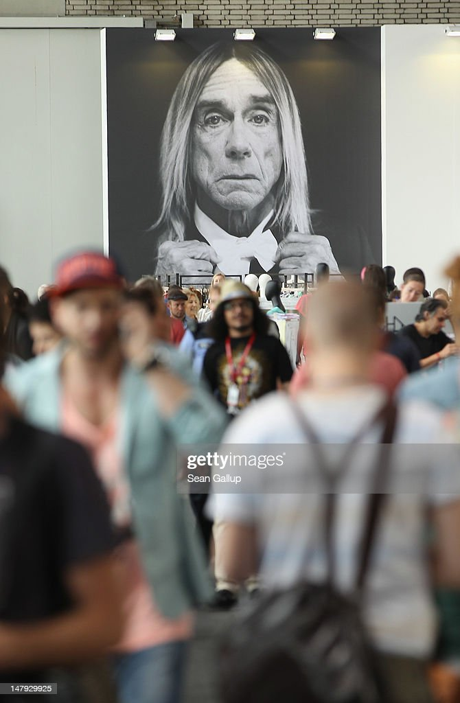 A portrait of Igga Pop with a bow tie looks out at visitors at the 2012 Bread & Butter fashion trade fair at former Tempelhof Airport on July 6, 2012 in Berlin, Germany. Bread & Butter is the world's largest trade fair for street fashion.