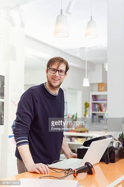 portrait of independent business owner at till