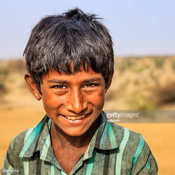 Portrait of Indian boy in desert village, India