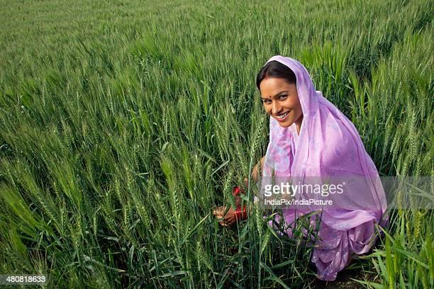 Portrait of Indian female farmer working in field