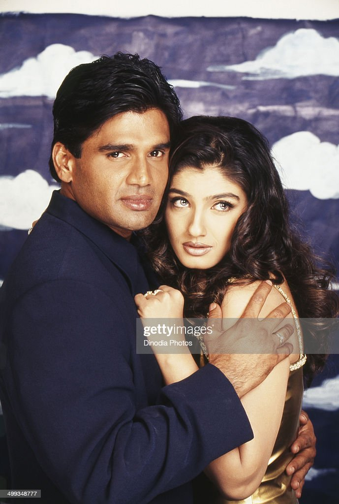 2001, Portrait of Indian film actor Sunil Shetty and actress <a gi-track='captionPersonalityLinkClicked' href=/galleries/search?phrase=Raveena+Tandon&family=editorial&specificpeople=3007225 ng-click='$event.stopPropagation()'>Raveena Tandon</a>.