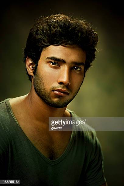 Portrait of Indian handsome, casual, young man looking at camera