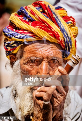 Portrait of Indian old man smoking