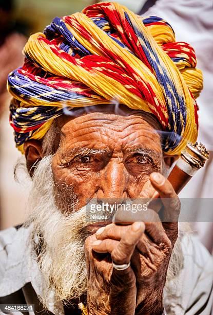 Portrait of Indian old man smoking