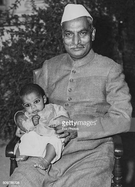 Portrait of Indian President Rajendra Prasad holding his three month old grandchild New Delhi January 31st 1950