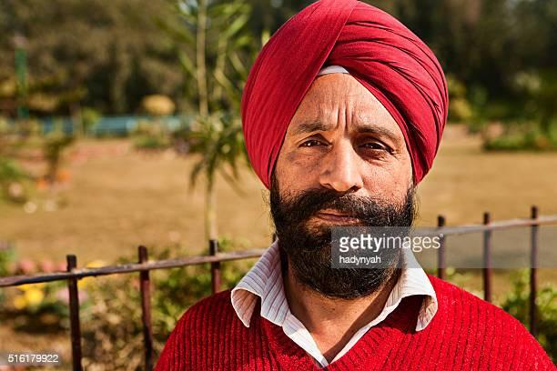 Portrait of Indian Sikh man near temple in Delhi
