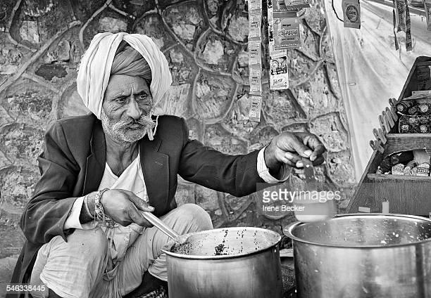 Portrait of Indian street seller selling tea masala chai Pushkar Camel Fair