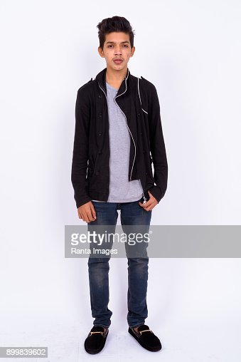 Portrait Of Indian Teenage Boy Against White Background : Stock Photo