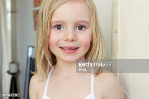 Portrait of innocent young girl in corridor